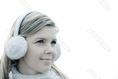 Cheerful cute girl in muffs