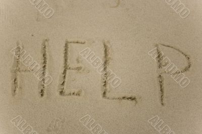Help sign on the sand