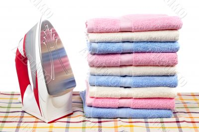 Electric iron and towels stacked