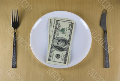Money on the plate