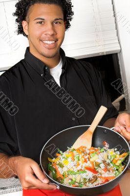 young chef presenting food