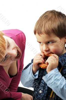 mom and her son eating one bagel