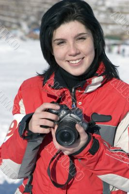 Attractive woman in sport wear holding a camera