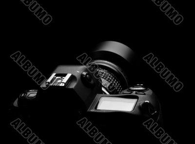 SLR camera on black spot light