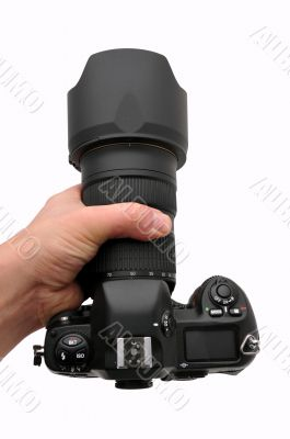 Camera SLR professional in hand isolated