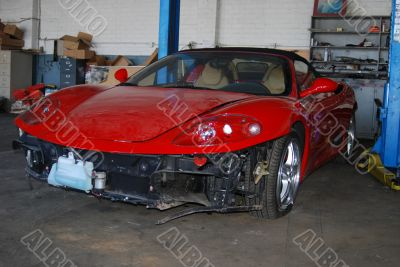 Dusty Damage red Sportscar