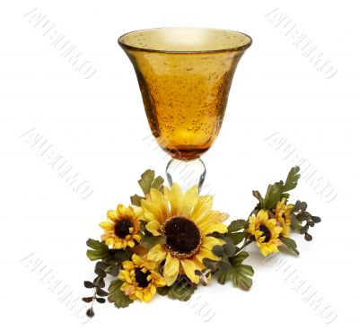Big yellow wineglass with bouquet of sunflowers