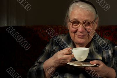 The darling old woman with favourite drink
