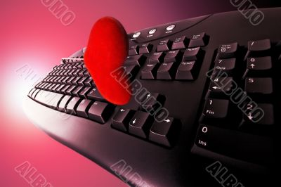 Concept Dating on-line in red. Keyboard and heart.
