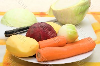 Peeled vegetables on a plate