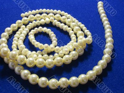 White beads from pearls on a dark blue background