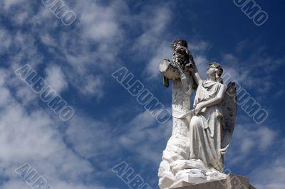 angel statue and cross