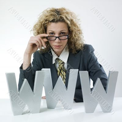 Businesswoman peering over glasses