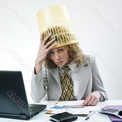 Woman with dustbin on head