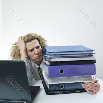 Angry woman with folders