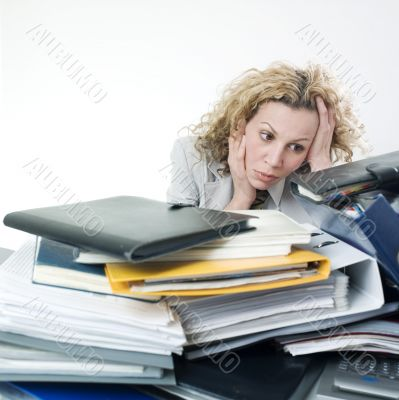 Desperated woman with folders