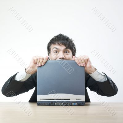 Happy man with computer