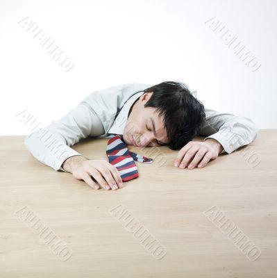 Businessman sleeping on a table