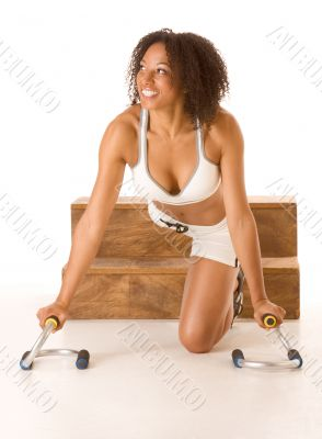 Dark skinned woman with push up bars