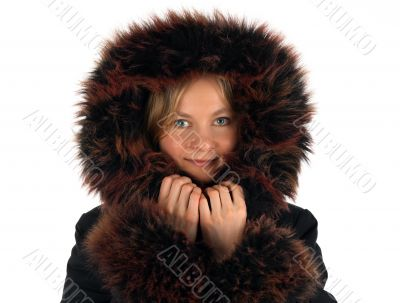 Smiling winter girl with a fur hood