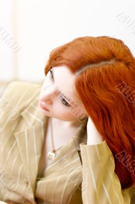 Attractive redhead woman in classic suit