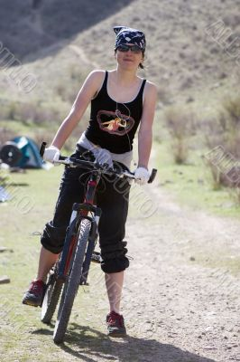 Girl in  bandanna by sport bicycle