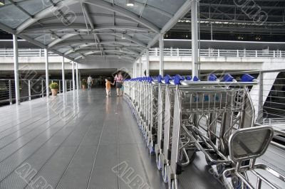 Airport Carts on walkway at Terminal Building