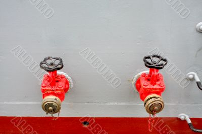 Firefighting taps at a military ship