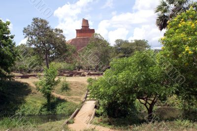 Stupa near river and trees