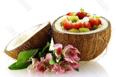 fresh fruit salad served in half coconut