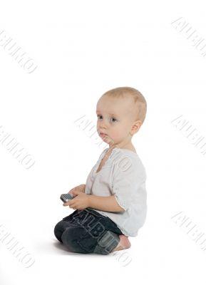 Sad boy with a cellphone