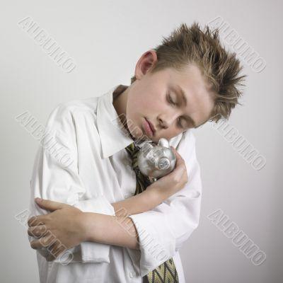 Boy huging piggy bank