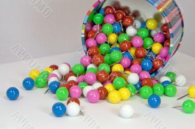 Assorted round thumb tack pins close-up
