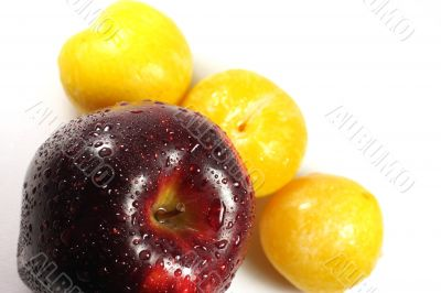Apple and yellow plums