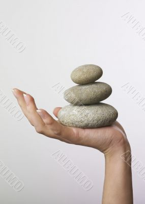 Hand holding stones