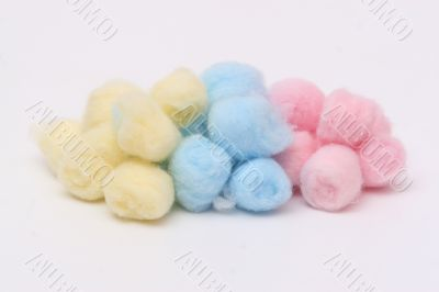 Yellow, blue and pink hygienic cotton balls