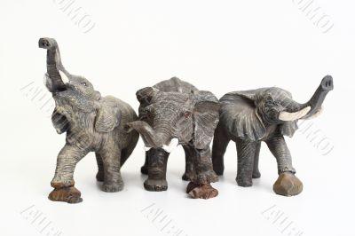 Three ceramic elephant figurines
