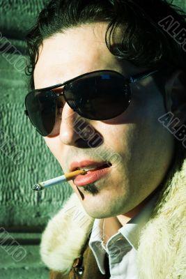 Sexy young man smoking cigarette