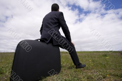 businessman sit in his baggage