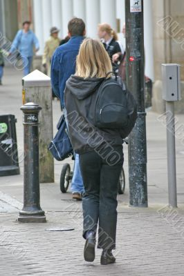 Blonde Woman Shopping with Backpack
