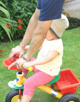 Toddler Learning to Ride Trike