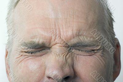 Man With Eyes Tightly Shut