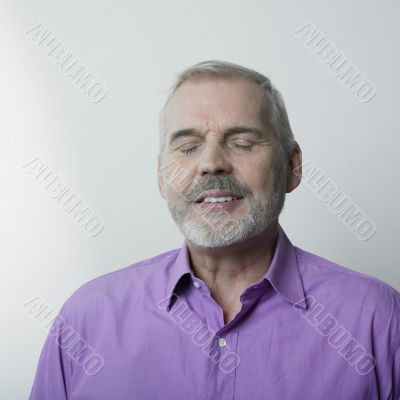 Smiling man with eyes closed