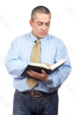 Business man reading a book