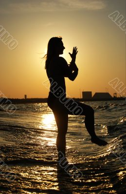 Sunset Tai Chi on a beach