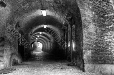 Gloomy medieval brick tunnel