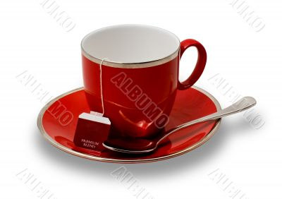 Isolated Empty Red Teacup and Saucer and Teabag