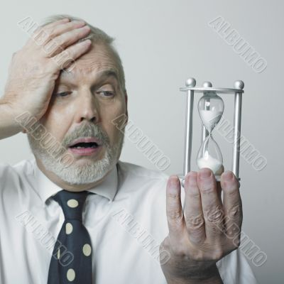 Desperated man with hourglass