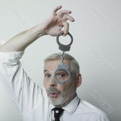 Man and handcuff