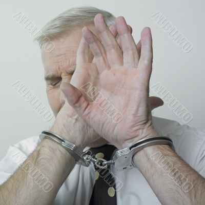 Handcuffed man and shame